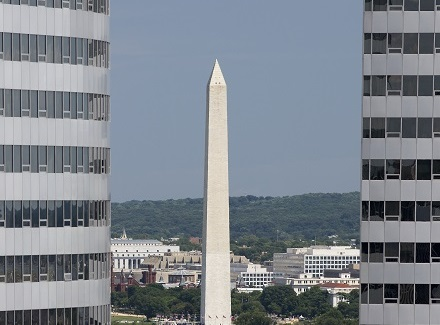Washington Monument Between Buildings